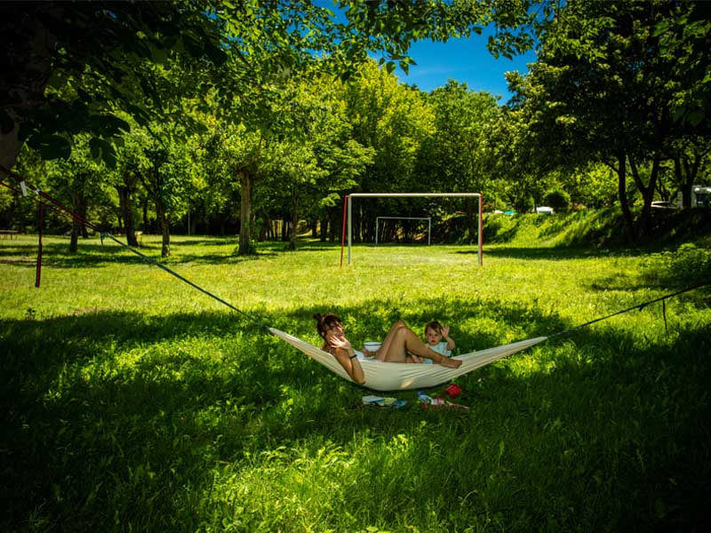 Family on hammock at playground