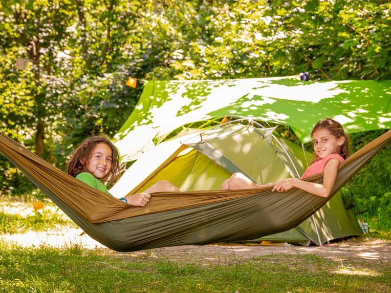 Children playing quietly in a hammock