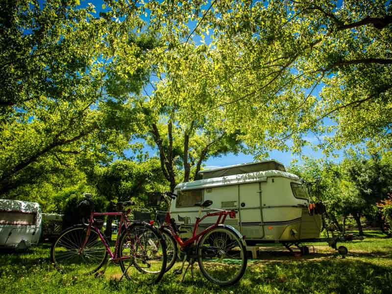 Caravan and bikes on a pitch on Plain